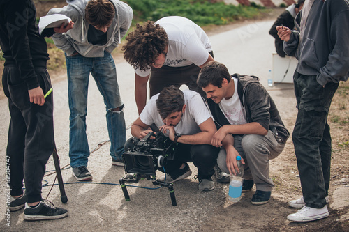 Behind the scene. Film crew filming movie scene outdoor Poster