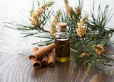 Coniferous tree essential oil and cinnamon stick