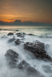 Long exposure shot of beautiful sunrise located at Pantai Pandak, Terengganu, Malaysia. Soft focus due to long exposure shot