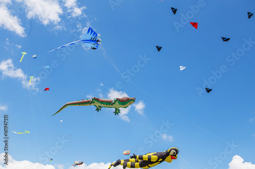 Keuken foto achterwand UFO kites flying in a blue sky. Kites of various shapes.