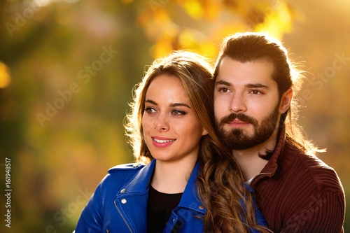 Cute couple hanging out in the park. Poster