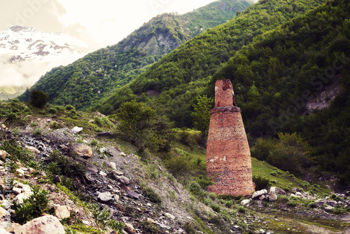 Abandoned industrial furnace against the backdrop of mountain peaks