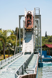 girls in boat on water slide attraction