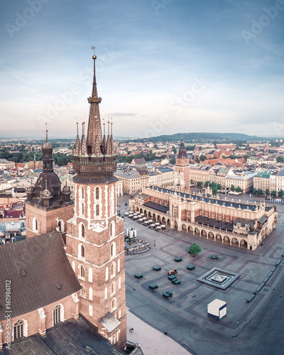 Fotobehang Krakau Aerial view on the main market square in Krakow and Marys Basilica