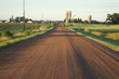 Rural Minnesota road with farms in morning light