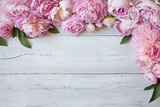 Pink peonies and roses on a wooden background - 161988912