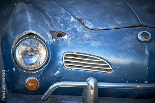 Vintage weathered unrestored blue German classic car with rust hole and tons of Poster