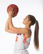 Teenage Girl shooting basketball