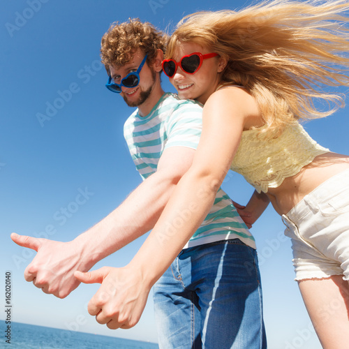 Couple friends showing thumb up gesture Poster