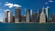 Time lapse! Fluffy clouds over financial district, Manhattan Island, New York City. Seen from Brooklyn.