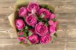 Pink peony roses in vase. retro styled photo.
