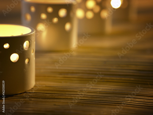 ..A row of tea light candles in holders