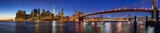 Panoramic view of Lower Manhattan Financial District skyscrapers at twilight with the Brooklyn Bridge and the East River. New York City - 162040778