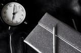 Black Alarm clock with Silver Organizer Notebook