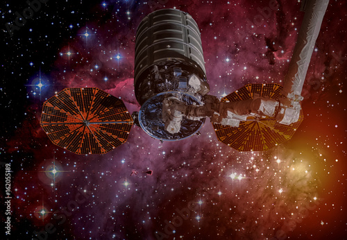 The Cygnus spacecraft in open space. Elements of this image furnished by NASA