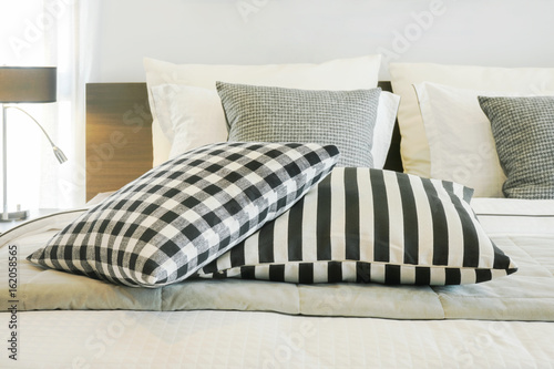 Black and white checked and strip pattern setting on bed