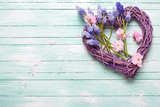 Big decorative heart and pink almond and blue muscaries flowers