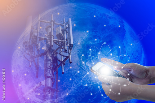 Foto op Canvas Nasa The concept of world communications, Smartphone in woman hand and Telecommunications tower on blue earth background, Elements of this image furnished by NASA