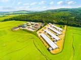 Aerial view over biogas plant and farm in green fields. Renewable energy from biomass. Modern agriculture in Czech Republic and European Union.  - 162070574