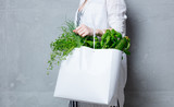 woman holding white bag with organic herbs - 162084988
