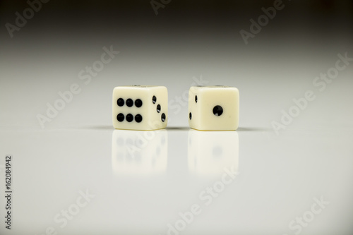 Two dice closeup on black and white background. плакат
