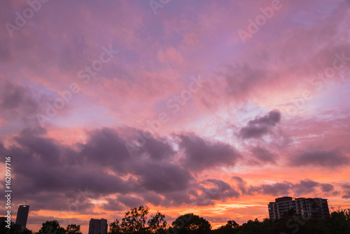 Aluminium A dramatic sunset cloud formation with vibrant colors across the sky at summer time in Houston, Texas, America. Nature in twilight period, beautiful landscape background.