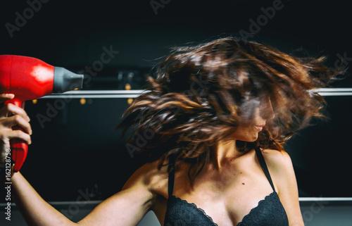 Woman hair dryer Poster