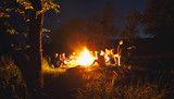 The company of young people are sitting around the bonfire and singing songs - 162147504