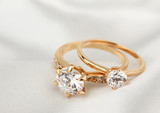 jewelry rings with diamond on white cloth, soft focus