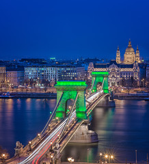 Chain Bridge with green lights on St. Patrick's day in Budapest