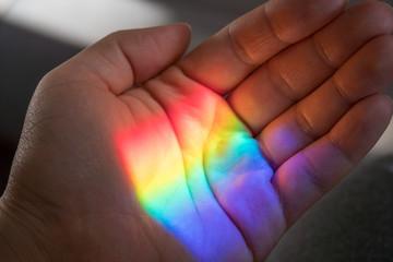 Rainbow sun light on a hand © azurita