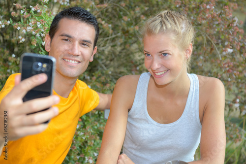 romantic couple take a selfie photo during hike in nature