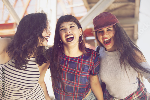 Happy group of female friends having fun in the city