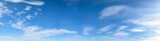 Panorama of blue sky background with white clouds on a sunny day - 162188184