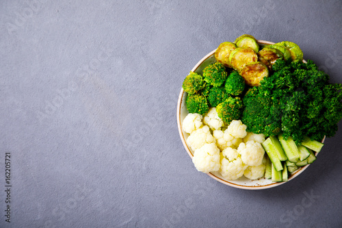 Raw mixed Vegetables and chickpeas.Vegetarian Buddha Bowl. Food or Healthy diet Concept.Super Food.Copy space for Text. selective focus.