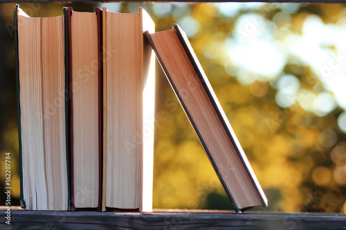 autumn book stack wooden outdoor - 162207784
