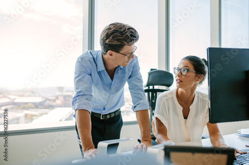 Business professionals working together in office Poster