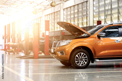 car repair station with soft-focus in the background and over light - 162230155