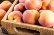 fresh peaches in a wooden box