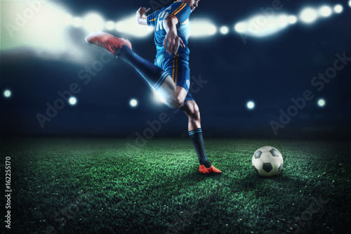 The active player of football at stadium in motion
