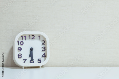 Closeup white clock for decorate show half past six or 6:30 a Poster