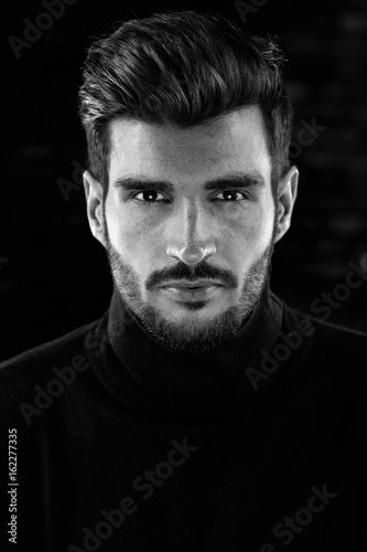 Black and white Portrait photo of cool young man