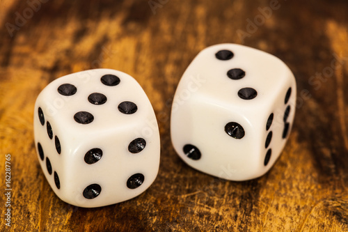 Two dices in table плакат