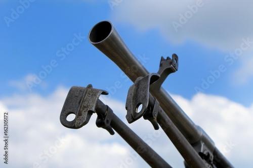 Poster Close up of barrel and tripod legs of a light machine gun