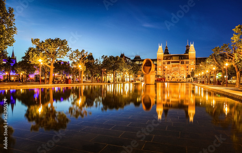 Amsterdam at summer night. Famous national Rijks museum general view.