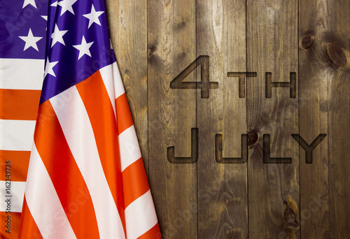 Poster 4th of July, the US Independence Day, place to advertise, wood background, Ameri