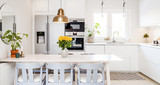 kitchen table with grey chairs in a white kitchen - 162359746