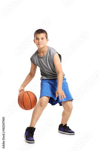 Fotobehang Basketbal Full length portrait of a kid playing with a basketball