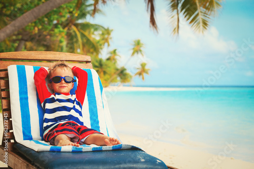 little boy relaxed on summer beach