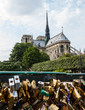 Love locks bridge and Notre Dame Cathedral at background.  Paris, France.